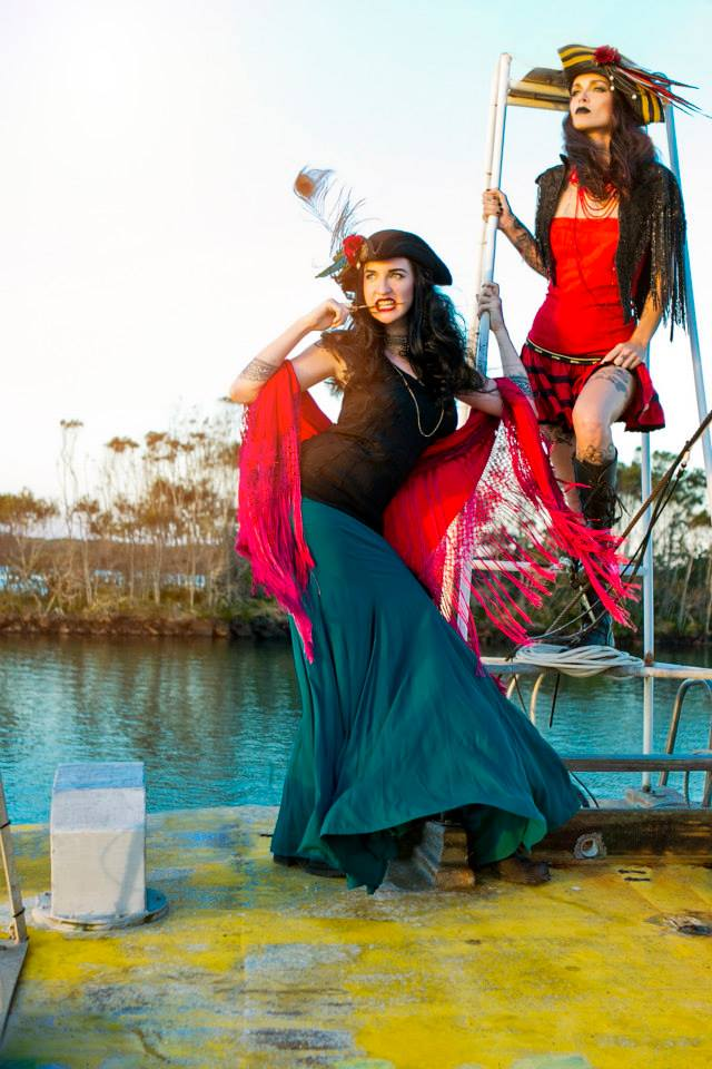 models fierce posing on fashion shoot on the the pirate boat