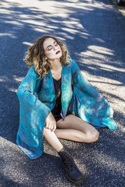 Model posing with Kaftan for Byron bay's Most Popular Fashion Photographer