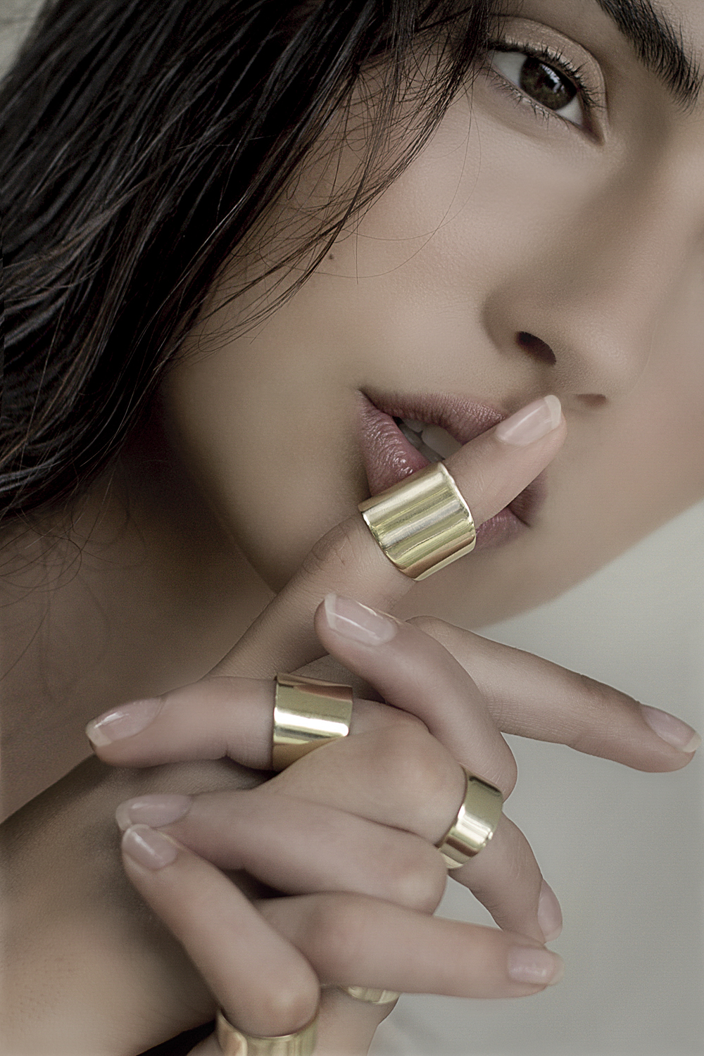 beauty shoot with golden rings by Donatella Parisini