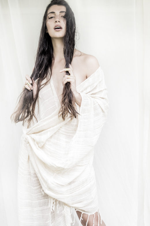 american indian mood with kaftan with beautiful girl posing ethereal mood
