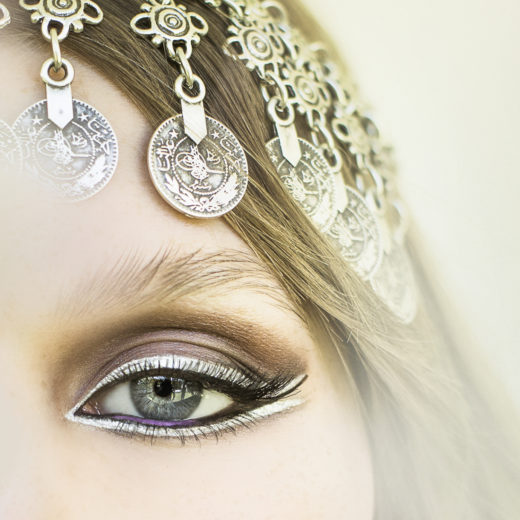 Silver eyeliner and purple pencil beauty shot