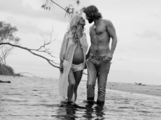 black and white beach pregnancy portrait couple love