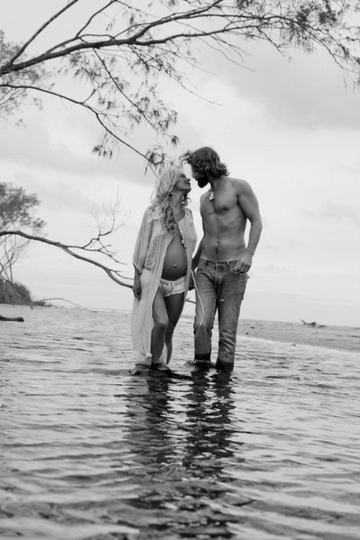 black and white beach pregnancy portrait couple love