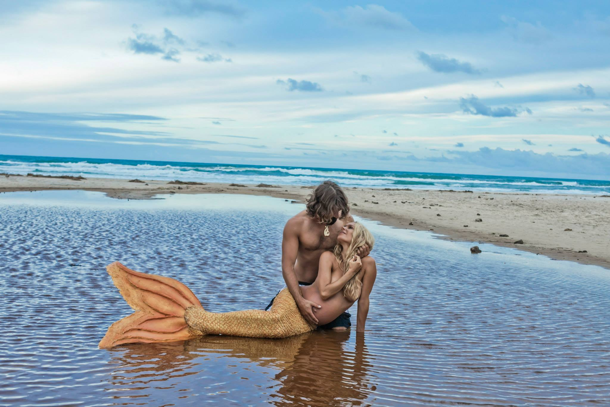powerful image of couple in byron bay mermaid kazzie mahina by donatella parisini