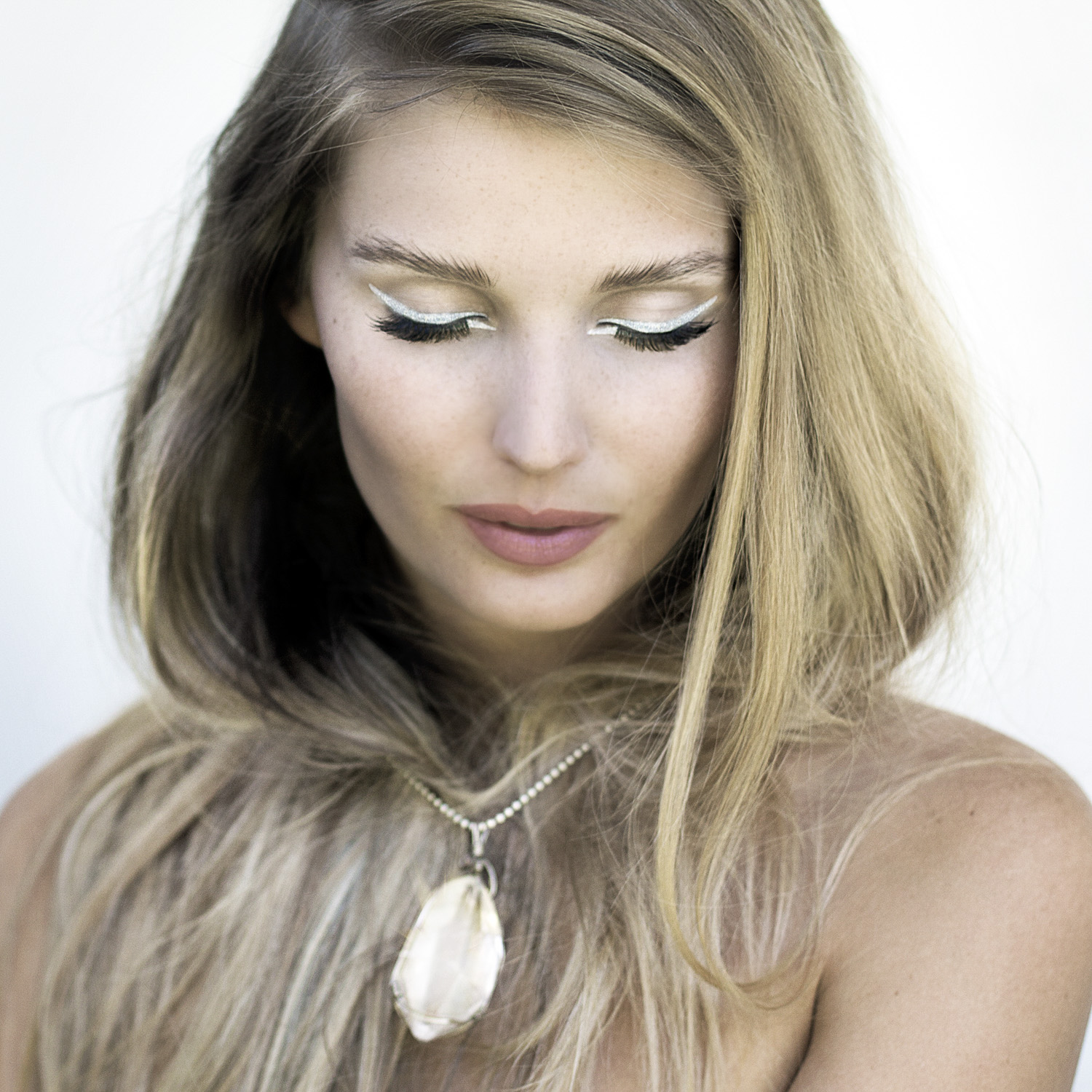 Cait provan with crystal and silver liner beauty shoot