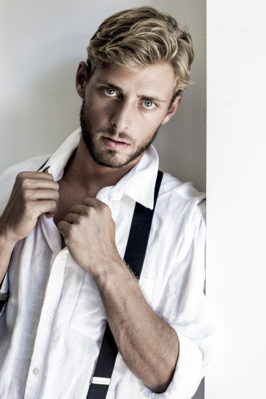 portrait of Male model's portfolio with suspenders