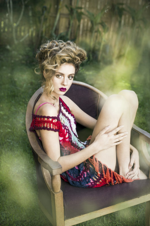 model on chair red lips for Byron bay's Most Popular beauty  Photographer
