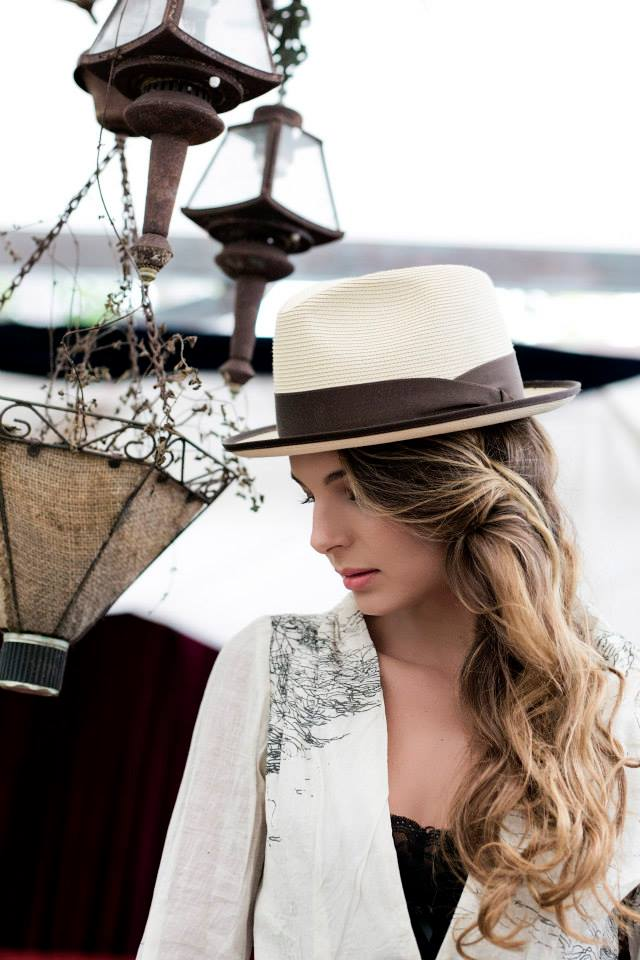 beautiful woman  wearing the Fedora Stetson hat